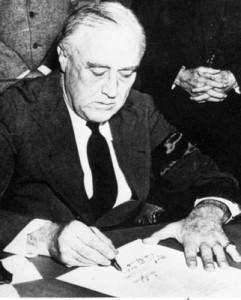 President Franklin D. Roosevelt signing the War Declaration against Japan