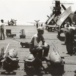 Rearming Hellcats on the deck of an aircraft carrier. Gift In Memory of John Valdemor Peterson, 2011.228