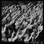 Pledge of allegiance with the Bellamy salute in Southington, Connecticut. May 1942 photograph by Fenno Jacobs.