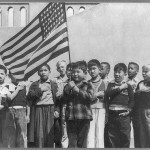 Students at the Weill Public School in San Francisco salute the flag. April 1942 photograph by Dorothea Lange.