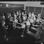 Children in a Rochester, New York school pledge allegiance with the Bellamy salute. March 1943 photograph by Ralph Andursky.