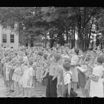 Children saluting the flag at Irwinville school in Georgia. May 1938 photo by John Vachon.