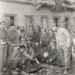 Group of Brazilian soldiers gather around a shell hole on the porch of the BEF command post in Italy.16 November 1944. Gift in Memory of William F. Caddell Sr., 2007.048