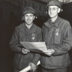 Capt. Eugene Barbero (left), a US ordnance officer assigned to the BEF, and Capt. Wilson Dickerson, a US field artillery officer, after being awarded the Brazilian military Order of Merit by Gen. Joao Batista Mascarenhas. 16 Novemebr 1944. Gift in Memory of William F. Caddell Sr., 2007.048