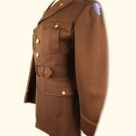 This service jacket was worn by Army Medical Corps physician Dr. Charles Prosser, Jr., who worked at both Oak Ridge and Los Alamos, without ever knowing what the men and women he treated were working on until the bomb was dropped on Hiroshima. Gift of Louise Prosser in Loving Memory of Dr. Charles S. Prosser, Jr. 2011.058