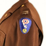 Military members working on the atomic bomb at Los Alamos wore this patch, whose design represents the splitting of the atom.  Gift of Louise Prosser in Loving Memory of Dr. Charles S. Prosser, Jr. 2011.058