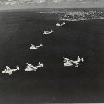 US Navy Martin Mariner seaplanes fly over the Atlantic on their way out from Bahia, Brazil. Gift of Charles Ives, 2011.102