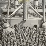 The 2nd Brazilian Expeditionary Force en route to Europe on the deck of a US Navy transport witness a Crossing-the-Line ceremony. 14 October 1944. Gift of Charles Ives, 2011.102