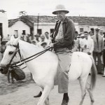 Southwest of Recife, Brazil, where a US air base was located, was a recreation center for men of the US Fourth Fleet. On horseback is Capt. Walter Gorden Roper, commanding officer of the center nicknamed Atlanta after his hometown. Gift of Charles Ives, 2011.102