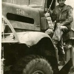 Snyder with his truck. He and Duchess would often take cover under the truck when there was shelling or incoming fire. Italy 1944 Gift of Howard M. Snyder, 2012.259