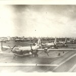 A row of B-29s lined up on a runway, location unknown. Gift of Donald McCaughey, 2012.006.006