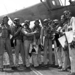 April 29, 1944.  Navy hellcat squadron pilots, all with A-14 oxygen masks, compare their scores by finger count.  Photo from Gregory Pons.