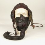 Predecessor of the A-14, the A-10A oxygen mask with flight helmet.  Gift of Robert Bannon, 2004.099
