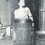 Comfort was in short supply for men working the Alcan. Here a Private bathes in an improvised tub.