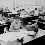 The JPL computing group, 1955. Barbara Paulson is on the telephone, standing back left.  Photo, JPL.