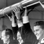 William Pickering, director of JPL, scientist James Van Allen, and Wernher von Braun show off a model of the Explorer 1 spacecraft during a press conference announcing the satellite's successful launch into space.  Photo, NASA.
