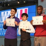 """Anh Hoang, Tien Huyn, and Tyrin Stevenson won first place in Senior Group Exhibit for their project, """"Rolling Revolution: How the Wheel Changed the World."""""""