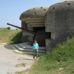 Rebekah Bass poses near a German gun at Longues sur Mer
