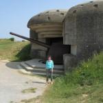Rebekah Bass poses near a German gun at Longues sur Mer