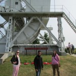 Natalie McDonald, Carey Burton, and Sara Allen pose near the original Pegasus Bridge