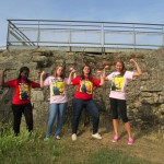 "Daniela Deny, Natalie McDonald, Sara Allen, and Rebecca Andruzzi show their ""We Can Do It"" spirit at Pointe du Hoc."