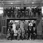 Ernest Lawrence (front row, fourth from left) with his team posing atop the huge magnet used in the 60-inch cyclotron, August 1938.  Image courtesy of the Lawrence Berkeley National Laboratory.