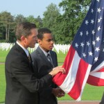 Students in the Normandy Academy participate in the flag raising ceremony at the Normandy American Cemetery.