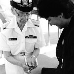 "Commodore Grace Hopper, USNR, autographs a ""nanosecond"" on September 27, 1985. Image courtesy of US Navy, from the collections of the Naval Historical Center."