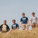 Normandy Academy students gaze out over the English Channel from the bluffs on Omaha Beach.