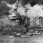 Rescuing survivors near the USS West Virginia after the attack on Pearl Harbor. Image courtesy of the National Archives.