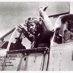 Photograph of Tuskegee Airman Captain Andrew D. Turner in his P-51 C fighter aircraft