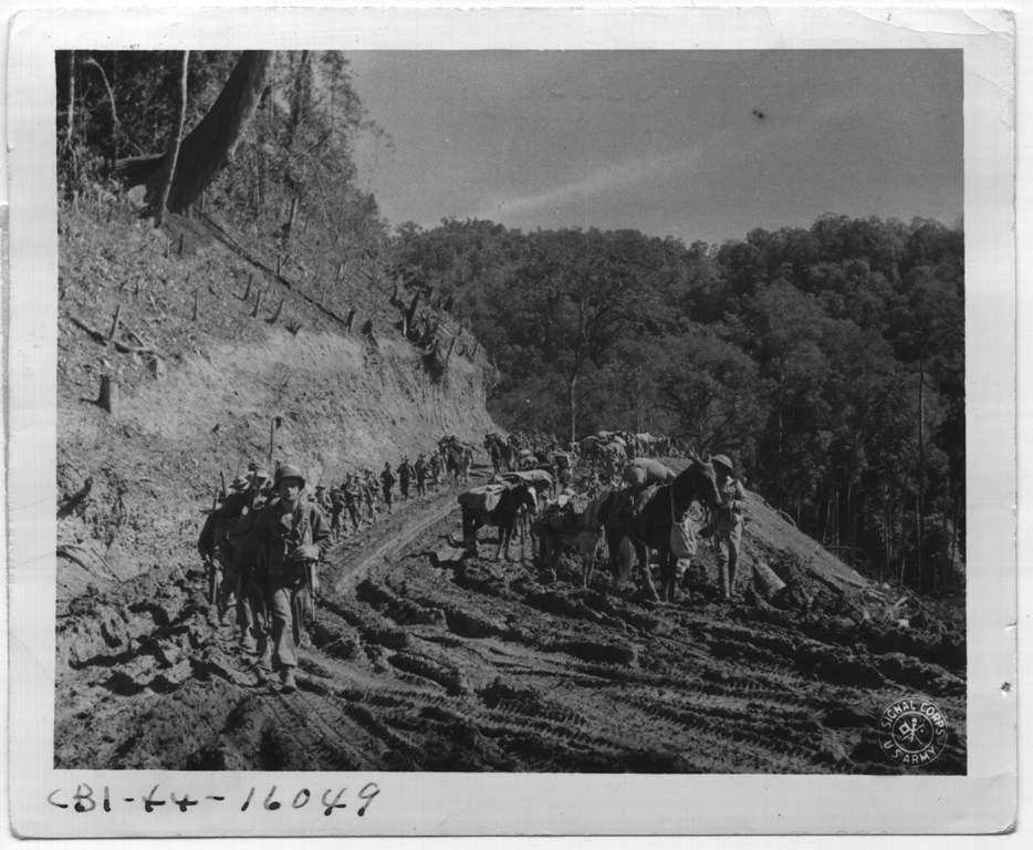 Merrill's Marauders and Chinese troops march side by side down the Ledo Road, February 1944. Image courtesy of the National Archives.