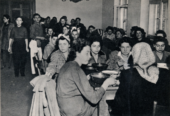 "Women from Salzwedel eating full meals for the first time in years. Image from Theadore Draper's book ""The 84th Infantry Division in The Battle of Germany."""