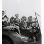 US Army nurses riding in a jeep during WWII. Gift of Bob Harris, from the collection of The National World War II Museum.