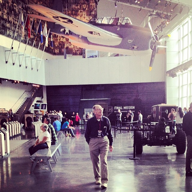 Craycraft on his 90th birthday walking among the warbirds hanging in the US Freedom Pavilion: The Boeing Center.