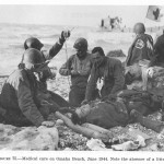 Plasma transfusion on Normandy beach, June 1944. Image courtesy of the U.S. Army Office of Medical History.