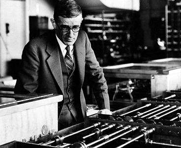 Vannevar Bush with the differential analyzer, an analog computer he helped develop in 1927 that could solve equations with 18 independent variables. Image courtesy of the MIT Museum