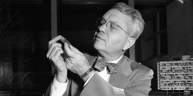 Dr. Harold Urey inspecting a fossilized belemnite in 1951. Image courtesy of the University of Southern California.