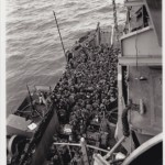 Hundreds of GIs boarding a ship in preparation for the D-Day beach landings. Image courtesy of The National Archives and Records Administration.