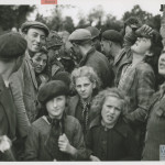 Liberated French citizens welcome American soldiers. 15 June 1944. U.S. Navy official photograph, Gift of Charles Ives, from the collection of The National WWII Museum, 2011.102.473.