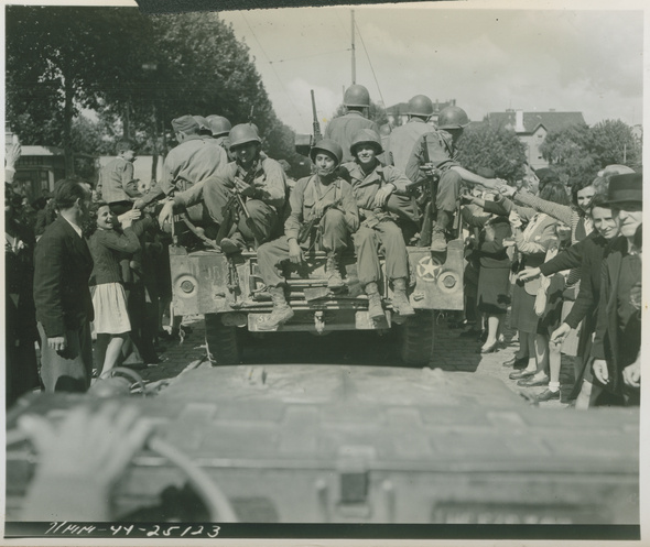 French civilians welcome US troops in Lyon, France on September 4, 1944.  U.S. Army Signal Corps photograph, Gift of Regan Forrester, from the collection of The National WWII Museum. 2002.337.938