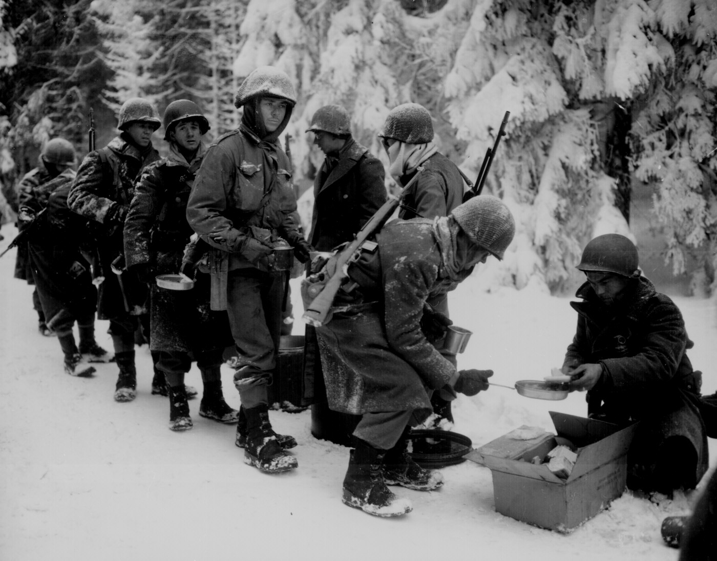 Chow is served to American Infantrymen (Courtesy National Archives)