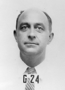 Not a mug shot--Enrico Fermi's photo for his Manhattan Project ID badge.
