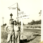 Two U.S. Army soldiers at a crossroads in Ghana in the 1940s. Possibly Air Transport Command. Gift of Jason Sloan, from the collection of The National WWII Museum.