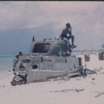An M4 Tank buried on the beach at Saipan in 1945. Gift of Lisle Neher, from the collection of The National WWII Museum.