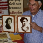 Mitch Cirlot holds a photo of Joseph Cirlot's wife Marion.
