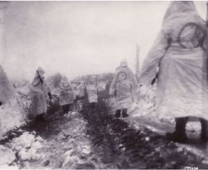 Men of the 2nd Infantry Division march through the snow. (Courtesy National Archives)