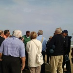 Author Alex Kershaw with tourgoers at Omaha Beach.