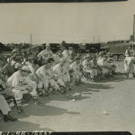 66th Inf team in foreground with the 71st Div band in background at baseball game between 5th Inf and 66Inf at Tiger Field, Sand Hill area, Fort Benning, Ga.