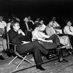 Oppenheimer and other scientists at a scientific colloquium at Los Alamos (from Wikimedia Commons)
